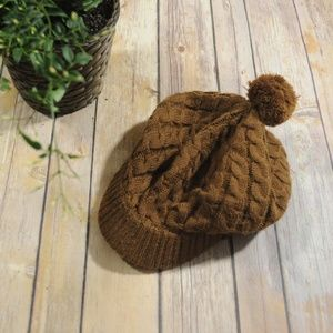 Brown cable knit brown beanie with pom-pom